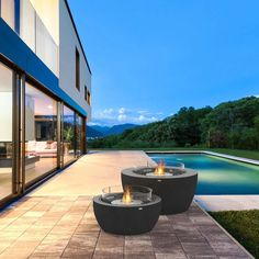 The graphite Bioethanol Fire Pit by EcoSmart Fire is a modern clean burning, eco friendly fire pit designed for outdoor or indoor. You can place this contemporary heater in your garden, patio or decking to create a warm and inviting focal point.