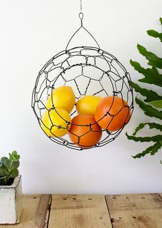 Hanging Sphere Wire Basket. Would work great with eggs too. Look neat with several at different sizes and heights with garlic etc. in them.