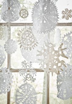 One of my favorite holiday activities - making paper snowflakes and covering the sliding glass doors with them.  #SplendidHoliday