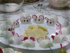 Hard boiled egg mice with radish ears. Not sure what the tails are.