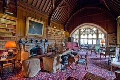 The library at Tyntesfield, a Victorian Gothic Revival estate in Somerset, England. The library contains one of the largest collections of Victorian books in England.