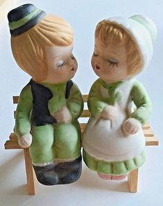 Cute Vintage Bisque Boy and Girl Sitting on a Wooden Bench Salt & Pepper Shakers