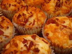 bacon cheese muffins: 2 - cups all purpose flour  2 - teaspoons baking powder  1/4 - teaspoon salt  1/4 - teaspoon black pepper  1 1/4 – cup milk  1/4 - cup butter or margarine, melted and cooled  1 - egg  1/2 lb - bacon, diced, cooked and degreased  3/4 - cup shredded cheddar cheese