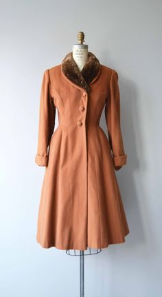 Vintage late 1940s, early 1950s muted burnt orange wool princess coat with brown sheared beaver shawl collar, asymmetrical buttons, fit and flare shape, cuffed sleeves, hip pockets and burnt orange silk lining.  --- M E A S U R E M E N T S ---  fits like: small/medium shoulder: 16 bust/chest: up to 37 waist: up to 29.5 hip: free sleeve: 23 length: 42 brand/maker: Carl of NY | Russeks condition: some moth dents in the back, not actual holes, but some damage, see close up photo  ...