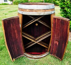 A Wine Barrel Bar would be a definite eye catcher and a conversation piece at any party or event! Handcrafted from a French white oak wine barrel imported from Frances finest wineries. It holds up to 45 wine bottles. This is one of our newest designs, it features a pair of lockable doors to keep your wine cool and away from sunlight Colors: Dark Walnut, Red Mahogany, Natural. Checkout our selection of Wine Barrel Bars here: https://www.etsy.com/shop/BarrelArtLLC/se...