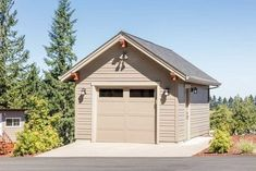 Lap siding, a flush door, three windows and a front gabled roof characterize this bright, detached garage. Garage Workshop Plans, Garage Plans, Garage Ideas, 5 Car Garage, Pump House, Flush Doors, She Sheds, Detached Garage, First Car