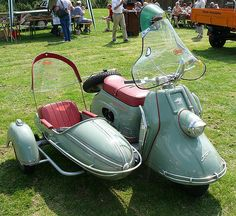 german heinkel scooter with side car.
