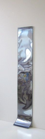carrie yamaoka |   64 by 12   reflective mylar, flexible urethane resin and mixed media  62 in x 12 in x 2 in   2006