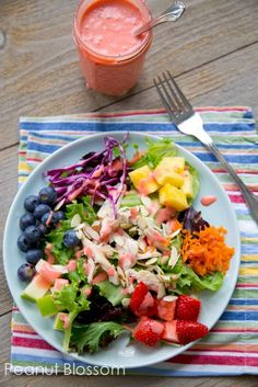 Healthy rainbow salad: Eat your colors! This kid friendly lunch can be deconstructed and eaten separately or tossed all together for mom. Love that homemade strawberry dressing! YUM. What a fun and healthy idea for St. Patrick's Day -- eat your rainbow!