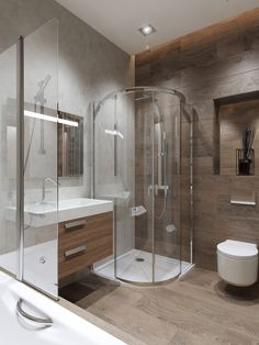 This stylish en-suite bathroom has some fantastic contemporary features like the corner shower enclosure and wall hung vanity unit.