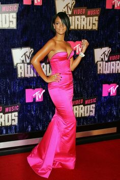 Rihanna Lookbook: Rihanna wearing Dark Nail Polish (7 of 22). Rihanna posed for the cameras at the 2001 MTV Video Music Awards, where she flaunted a perfectly polished dark manicure.