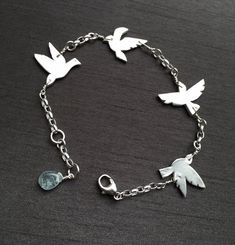 "Dainty Birds Bracelet; the birds are handcrafted in fine silver(.999%) and wire wrapped on sterling silver chain. Length can be self adjusted from 7""-7.5"" Perfect gift for the bird lovers! ($65) #animaljewelry #birdbracelet #modernjewelry"
