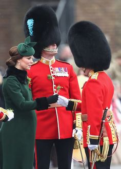 Kate Middleton Photos - Catherine, Duchess of Cambridge presents the 1st Battalion Irish Guardsmen with shamrocks during the annual Irish Guards St Patrick's Day Parade at Cavalry Barracks on March 17, 2018 in Hounslow, England. - The Duke And Duchess Of Cambridge Attend The Irish Guards St Patrick's Day Parade