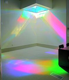 Magenta and green rainbow light in library. Erskine Solar Art