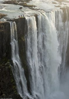 On the Edge, Victoria Falls, Zambia  -  These guys are just f#$%ing crazy!!