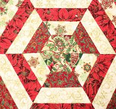 This beautiful hexagon shaped Quilted Table Topper for Christmas will be amazing on your table. The colors are bright red, green, ivory and some gold highlights. There are lots of poinsettias. The pattern is called a Kaleidoscope and is made from six large pieced triangles. This is MADE TO ORDER. Turn around time is about 7 days from time of payment.  The table topper is quilted with swirls in every fabric piece and in the ditch (in the seams). The red binding is sewn on with a cute wavy…