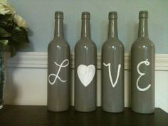 Want to do this with 6 bottles and write Family...to put on the plant shelf in the Family room