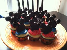 Easy Micky Mouse cupcakes made using one large Oreo and two mini Oreos glued together with melting chocolate. I just placed my Mickie's on top of the icing but my friend suggested using a toothpick to secure them in place. (Tip- use double stuffed Oreos. They hold up better)