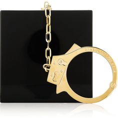 Charlotte Olympia Handcuff Perspex clutch found on Polyvore