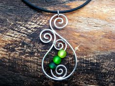 Necklace - Aotearoa - with Polarisbeads  GREEN   New Zealand Koru wire wrapped. €11,00, via Etsy.