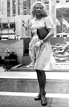 1940s street style in New York found street photo woman in white striped dress day casual office cotton summer short sleeves square neckline shoes purse gloves hair 40s war era