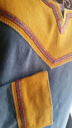 Linen viking tunic made for Jeff Justice by Angela Renee Wilmot. Card woven trim by Jennifer Walters