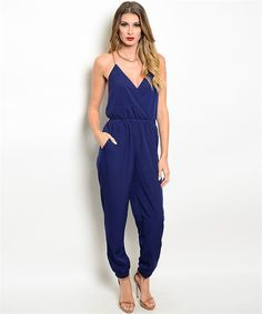 Gorgeous Navy Jumpsuit features a V-neckline with chain strap detail in back. Perfect for a girls night out! | Shop this product here: spree.to/ahmg | Shop all of our products at http://spreesy.com/Neb_Chic_Fashions    | Pinterest selling powered by Spreesy.com