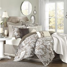 Comforter set with a white floral motif.  Product: Queen Set: 1 Comforter, 1 bed skirt, 2 standard shams, 2 euro shams an...