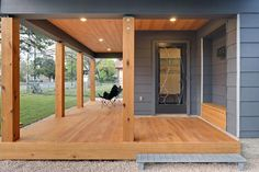 Interesting but an absolutely hideous step up to the deck. Modern design meets country porch at eco-friendly house in austin, tx