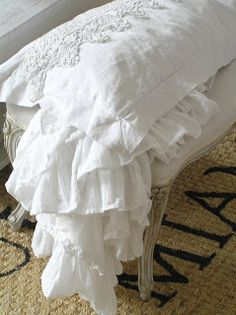 delicate white linen and lace pillow shams