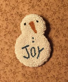 A personal favorite from my Etsy shop https://www.etsy.com/listing/253819870/primitive-needle-punch-pin-snowman-joy