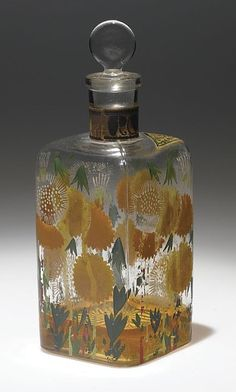 """*1920 perfume  bottle by Paul Poiret, 1920.  Couturier Paul Poiret named his perfume business after daughter Rosine, and his painting studio after daughter Martine. This large clear glass bottle for """"Le Veritable Eau de Cologne"""" was hand decorated by Atelier Martine.20cm"""