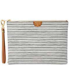 """Cool and compact, Fossil's printed faux leather wristlet stows your have-to-haves like cash, cards and even your phone. 