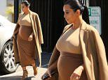 Pregnant Kim Kardashian leaving a studio the day after Kanye West tells the Americas he will run for 2020 presented.\n\nPictured: Pregnant Kim Kardashian ,Kanye West\nRef: SPL1110202  310815  \nPicture by: Clint Brewer / Splash News\n\nSplash News and Pictures\nLos Angeles: 310-821-2666\nNew York: 212-619-2666\nLondon: 870-934-2666\nphotodesk@splashnews.com\n