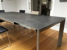 Urban ceramic top extendable dining table. Smooth mechanisms, with stylish angled legs. Delivered to our client in Epsom.