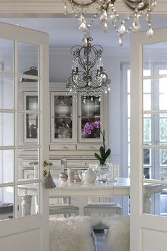 chandelier, french doors, all white repaint dining room furniture white??  cream?
