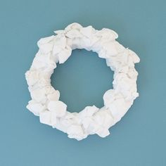 This wreath is made of paper plates, t-shirts, tape and rubber bands! Follow this quick and easy tutorial & have it hanging within an hour!