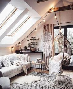 Feel inspired by this beautiful bohemian living room - fresh white is perfectly balanced with light wood and contrasting black details. Ideal for those that love monochrome decor, bohemian decor and Scandinavian interiors. Click the link for more bohemian decor ideas... #bohemian #bohemiandesign #bohemiandecor #homedecor #interiors #interiordesign #Scandidecor #Scandihome #Scandinavian