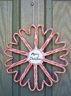 Candy cane heart wreath, I'd put a big bow in the middle to decorate it more with a pin in the center labeled with merry x-mas.