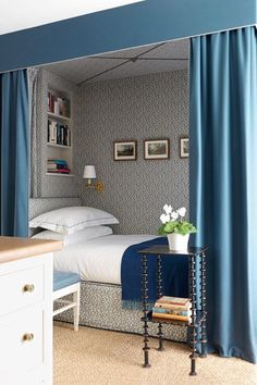 Lovely canopy bad turned into a nook by Veere Grenney. Blue and white Schumacher fabric and wallpaper.