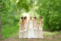 champagne long dresses bridesmaids white bouquet. love the slight contrast between the bride and bridesmaids