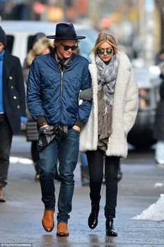 Casual cool: Cody wore a black fedora style hat with a blue quilted bomber jacket with a p...