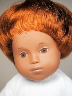"""Close up of 12"""" Claudia Sasha Baby doll, wearing original one-piece pajama (and blue """"nest"""" not pictured), Germany, 1997, by Götz."""