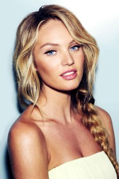 Candice Swanepoel looks dewy and gorgeous with this glowing makeup and messy fishtail braid