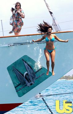 Kim jumps overboard as Khloe looks on...