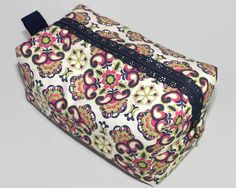 Unique make-up bag with (lace) zipper and strap to hold toiletries, make-up, etc. Washing machine safe on gentle cycle cold and air-dry for easy