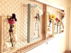 From Flamingo Toes. I LOVE the idea of little glass bottles hanging in painted frames. Bookmarked under crafts. She used a chicken wire screen door hanging on the wall. What a clever idea!