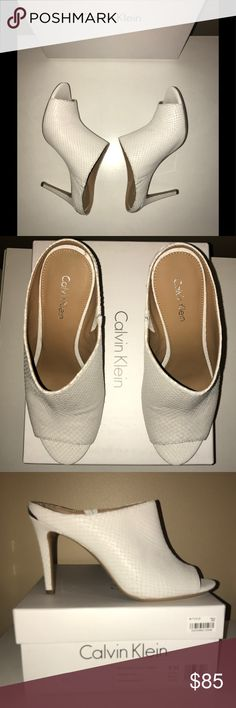 "🆕✳️CALVIN KLEIN ✳️""Nola"" Matte Cut Snake Open Toe 🆕LISTING🆕NIB✳️CALVIN KLEIN ✳️""Nola"" Matte Cut Snake Open Toe Leather Heels/ Mules. Size- 8. Platinum White color. Padded insole. Rubber sole. Heel height- 4"". Original cost $110. Calvin Klein Shoes Heels"