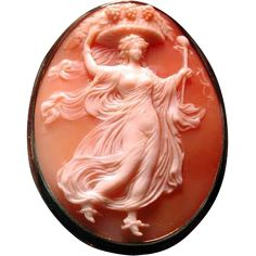 This is a WONDERFUL CAMEO OF A WOMEN WITH A BASKET ON HER HEAD.Fabulous carving.The setting is 14 kt gold not marked but tested.She even has fancy