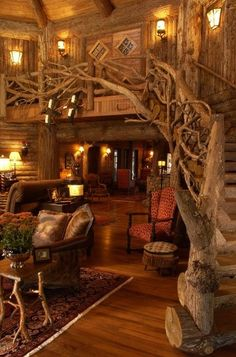 Tree-like branches make these stairs look magical.  Notice the warm lighting and colors throughout that makes this room feel like a fairy tale.  #decor #magic #whimsy